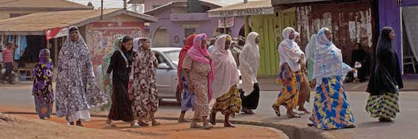 A group of women passing by in a Muslim neighborhood.