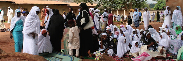 Women and children get ready to start prayer at a conservative Eid al-Fitr celebration.