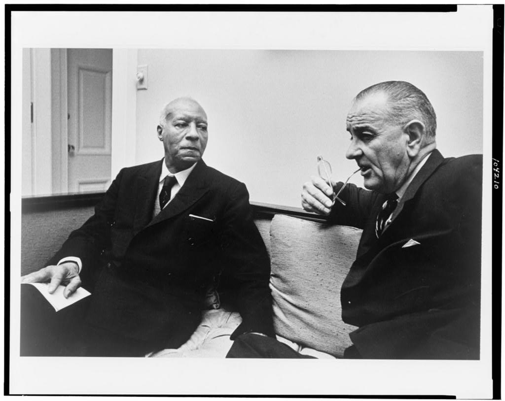 Asa Philip Randolph seated with President Lyndon Johnson