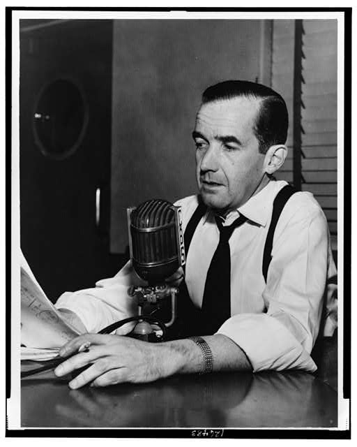 Edward R. Murrow, half-length portrait, seated behind CBS microphones, turned left