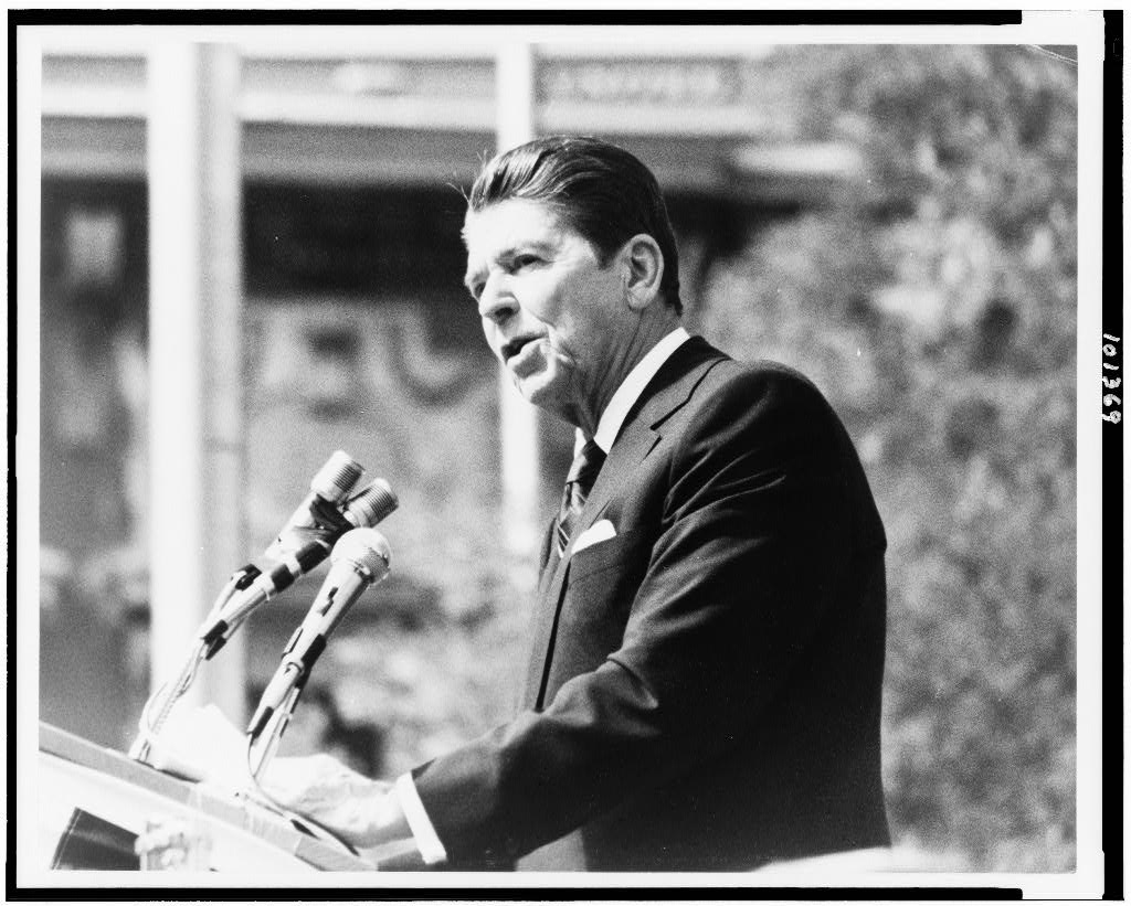 Ronald Reagan, half-length portrait, standing, facing left, making speech