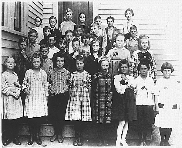 Photograph of Ronald Reagan's (second row, first from the left) third grade class Photo