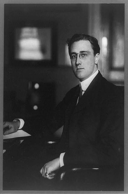 Franklin Roosevelt, three-quarter length portrait, seated, facing left