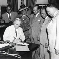 President Harry Truman Signs the Bill Proclaiming February First as National Freedom Day